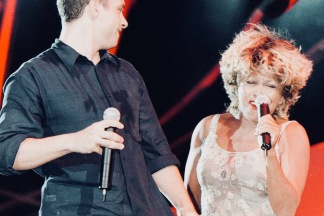 Italian super-star Eros Ramazzotti performs with his US colleague Tina Turner during his concert on stage in Milan's San Siro Stadium late 22 May.